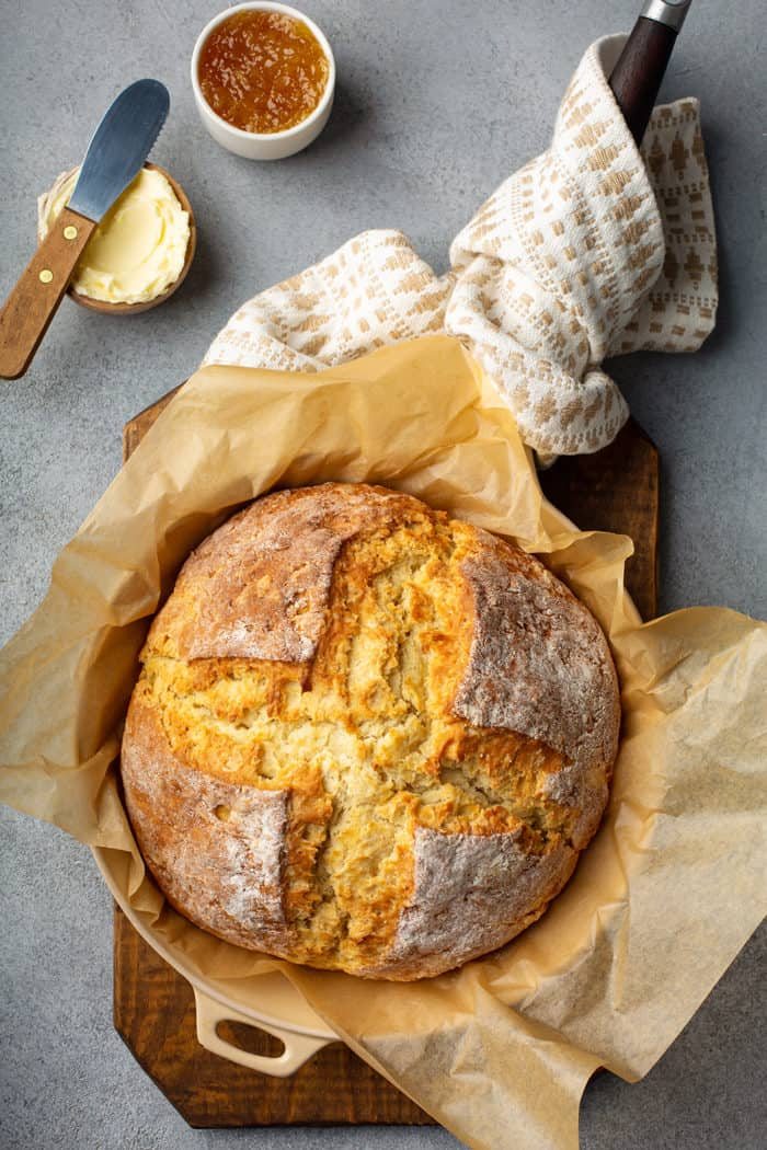 Baked loaf of irish soda bread in a cast iron skillet