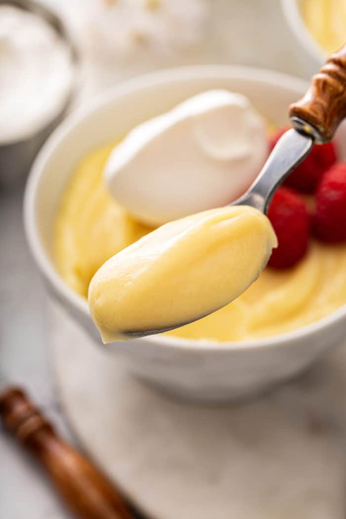 Spoonful of vanilla pudding being held up to the camera