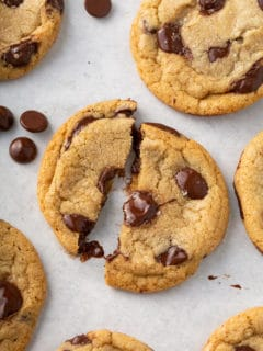 Brown butter chocolate chip cookie broken in half to show the gooey melted chocolate chips