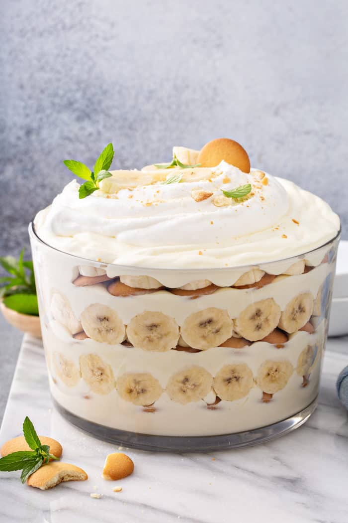 Side view of Magnolia Banana Pudding assembled in a trifle dish, topped with whipped cream