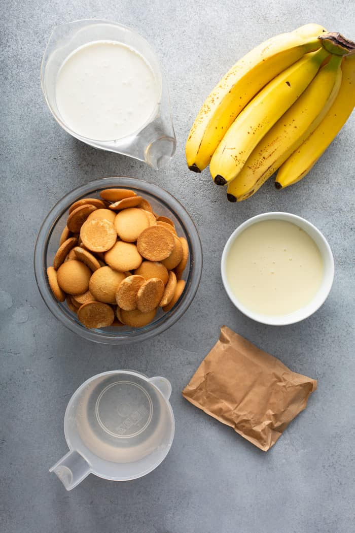 Ingredients for Magnolia Banana Pudding arranged on a gray countertop