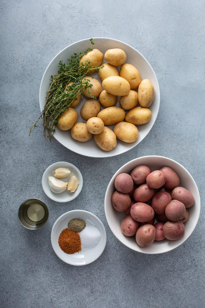 Ingredients for air fryer roasted potatoes on a gray countertop