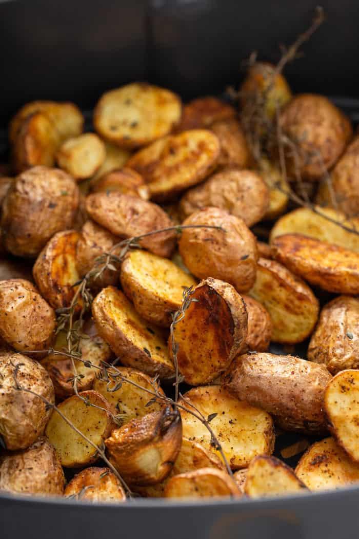 Freshly roasted air fryer potatoes in an air fryer basket