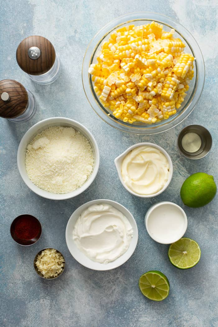 Ingredients for Mexican street corn salad arranged on a countertop