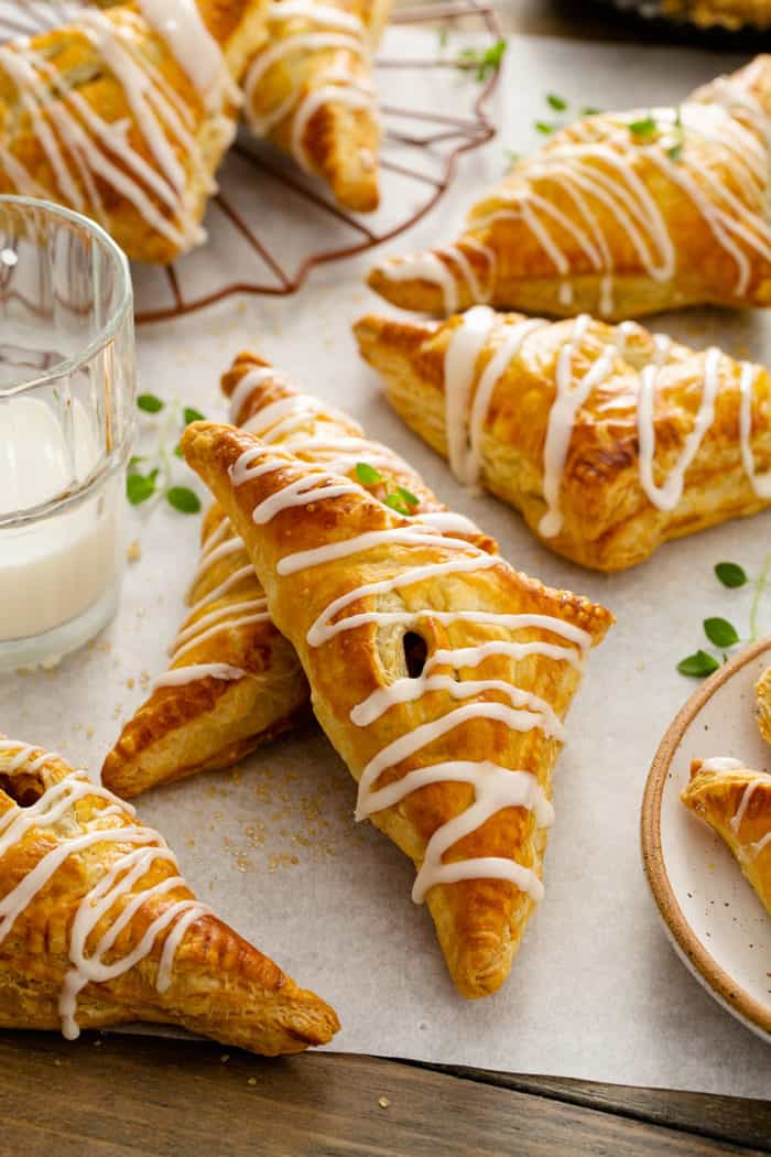 Baked apple turnovers on a piece of parchment paper