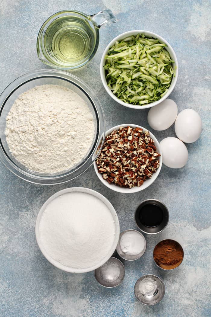 Ingredients for zucchini bread arranged on a countertop