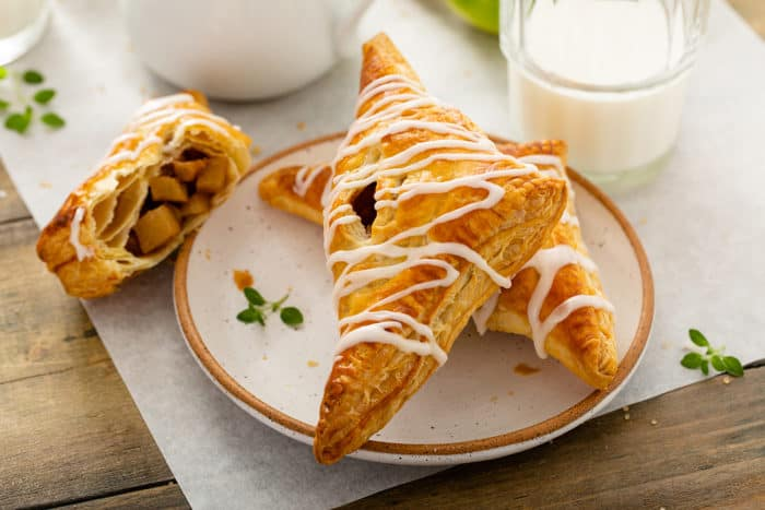 Plated Apple Turnovers next to a glass of milk