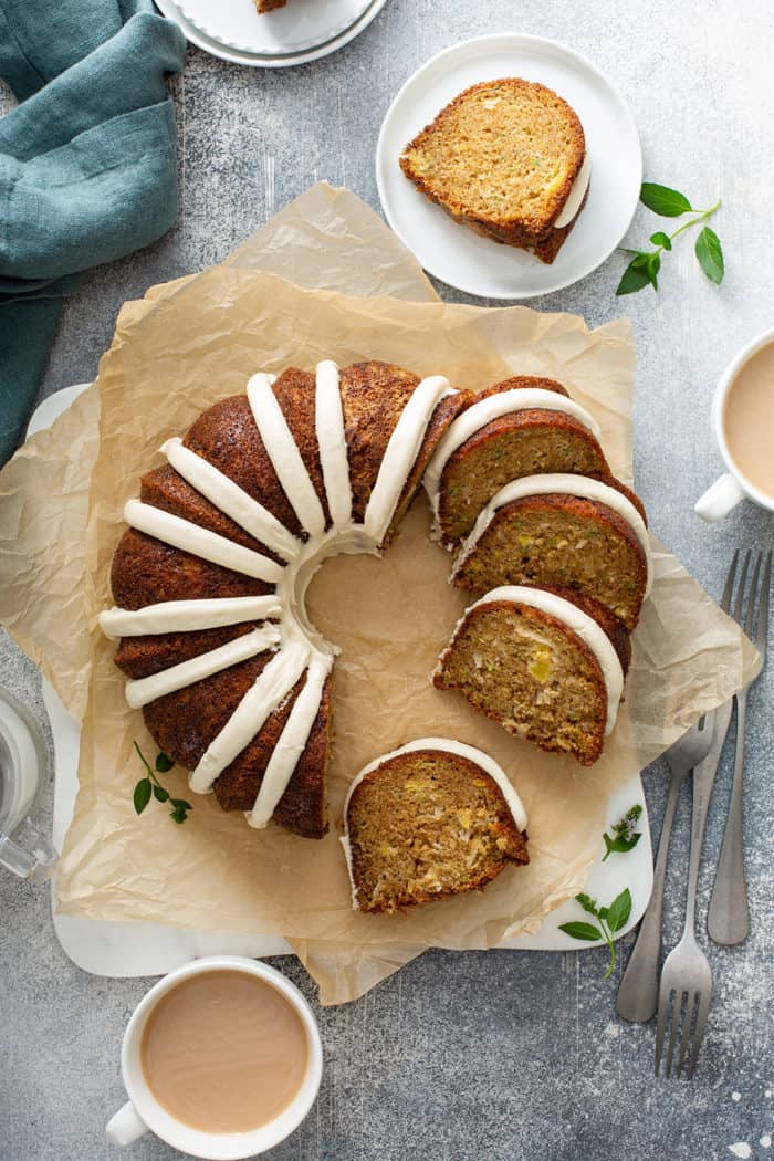 Overhead view of sliced zucchini bundt cake on a slice of parchment paper