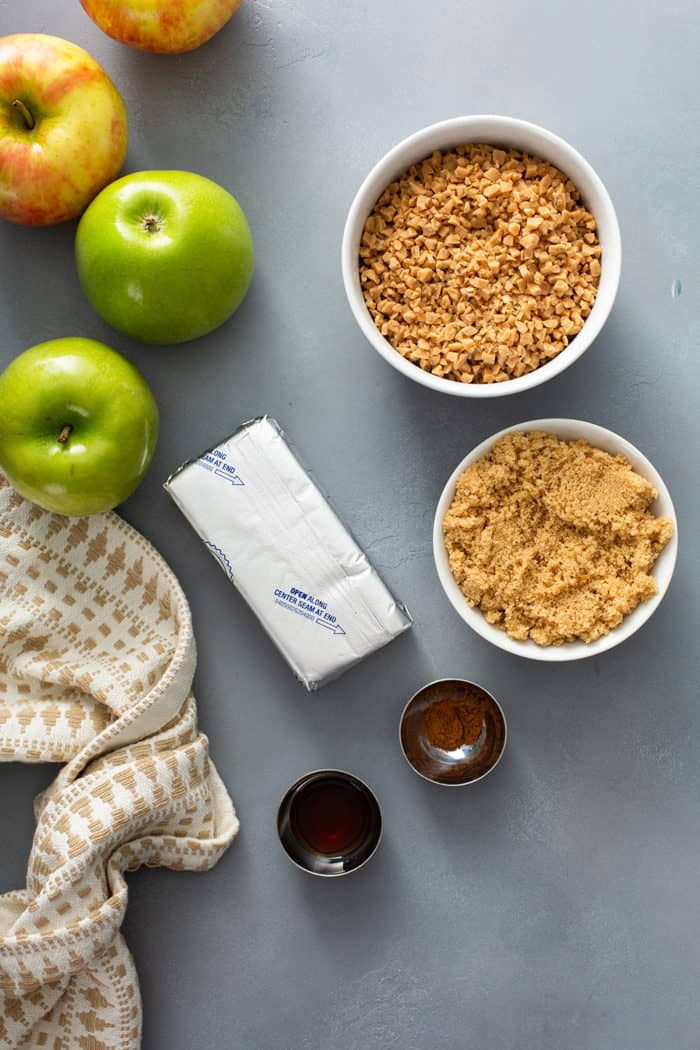 Ingredients for toffee apple dip arranged on a gray countertop