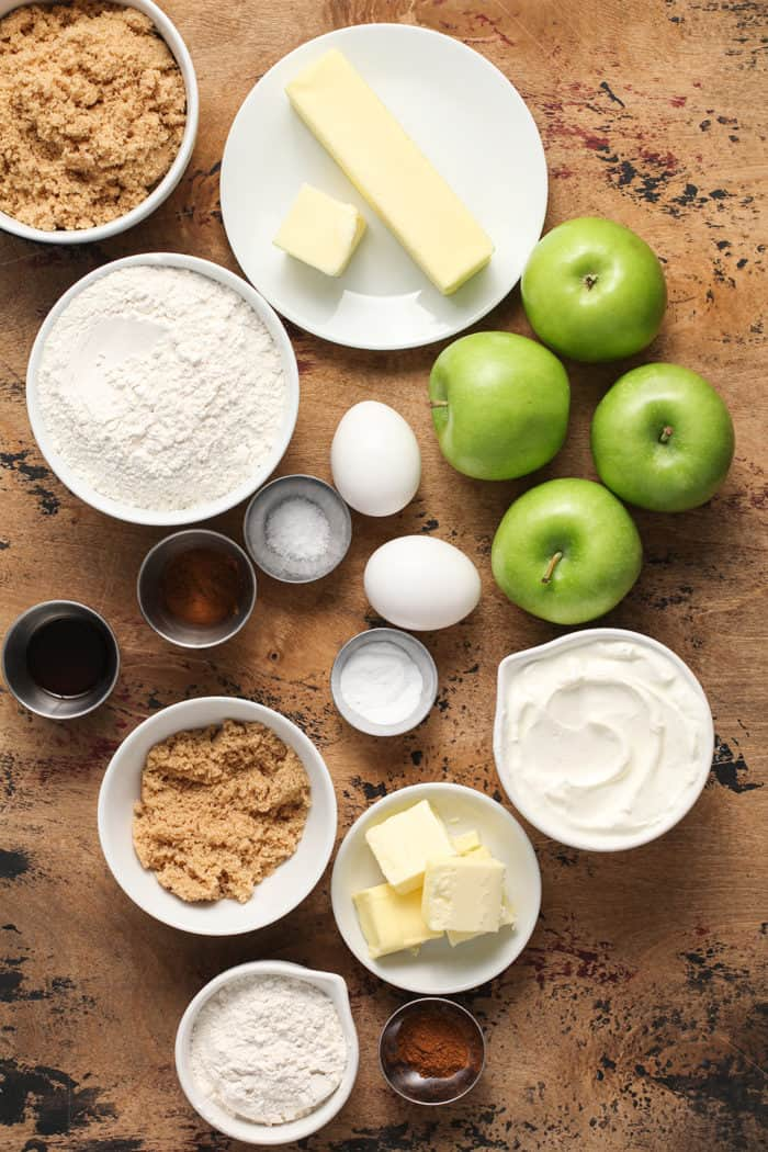 Ingredients for apple coffee cake arranged on a wooden countertop