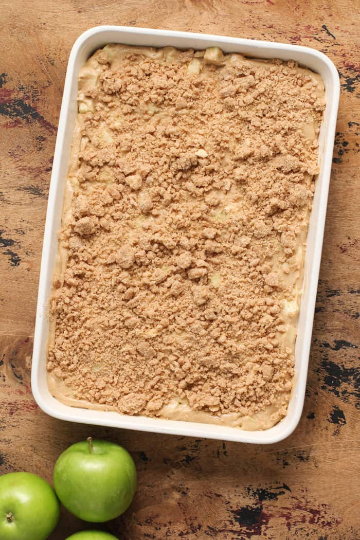 Apple coffee cake batter in a baking dish, ready to be baked