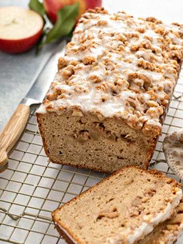 Sliced apple fritter bread set on a wire cooling rack