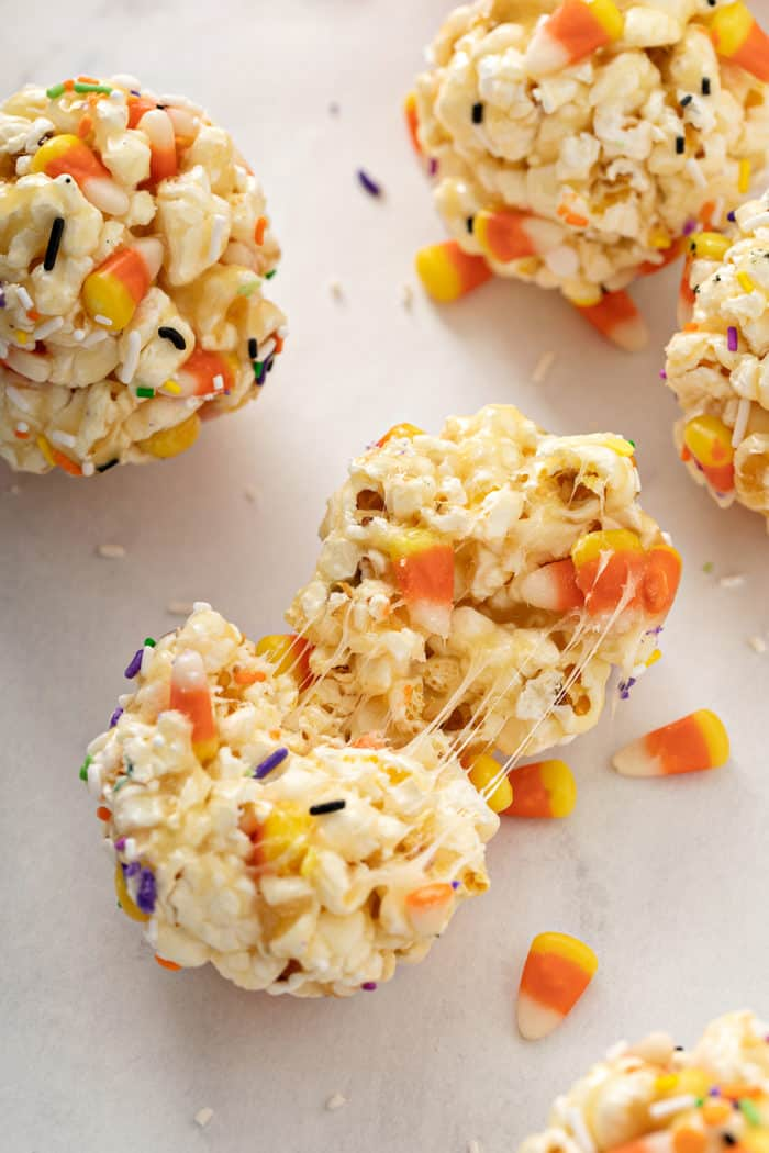Halloween popcorn ball torn apart to show the sticky inside