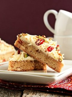 Close up of cranberry bliss bars on a plate