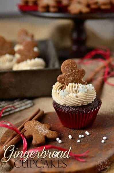 Gingerbread cupcake topped with a small gingerbread man cookie